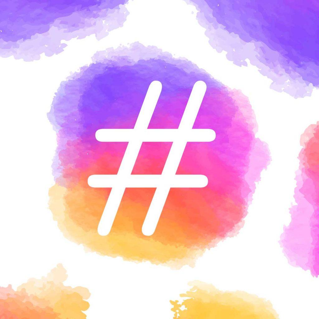 Imagem com uma hashtag em uma arte com a identidade visual do instagram, hashtags ajudam a ganhar seguidores no instagram