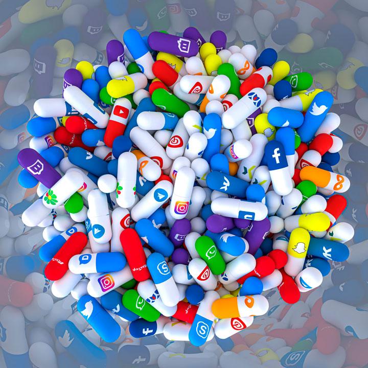 Imagem com várias pílulas de remédios, onde cada uma é representada por uma rede social.