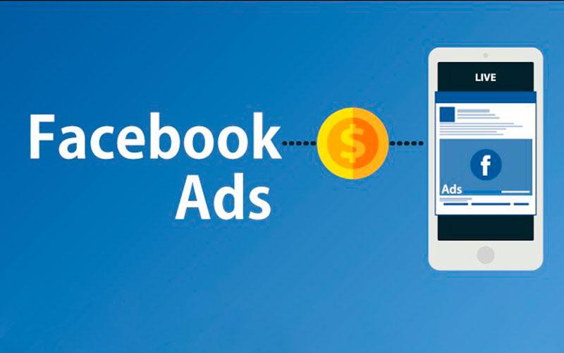 Facebook Ads traz muitas vantagens ao seu negócio, imagem ilustra uma moeda entre a inscrição Facebook Ads e um smartphone com o Facebook aberto.